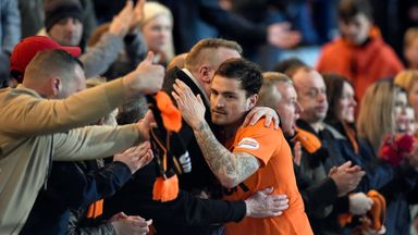 Paul Paton and supporters commiserate each other following Dundee United's relegation