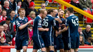 Ross County players celebrate after Martin Woods puts them 4-0 up at Aberdeen