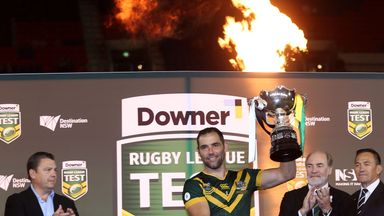 Cameron Smith of the Kangaroos holds aloft the Bill Kelly Memorial Trophy