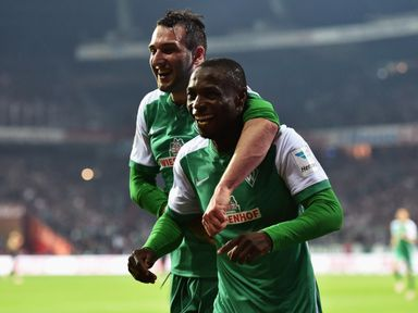 Anthony Ujah (r) celebrates scoring his side's sixth goal
