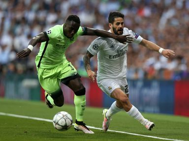 Manchester City's Bacary Sagna and Real Madrid's Alarcon Isco (right) battles for the ball during the UEFA Champions League Semi Final, Second Leg match at