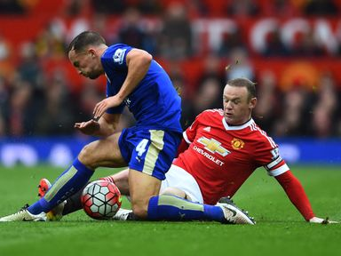 Danny Drinkwater is tackled by Wayne Rooney