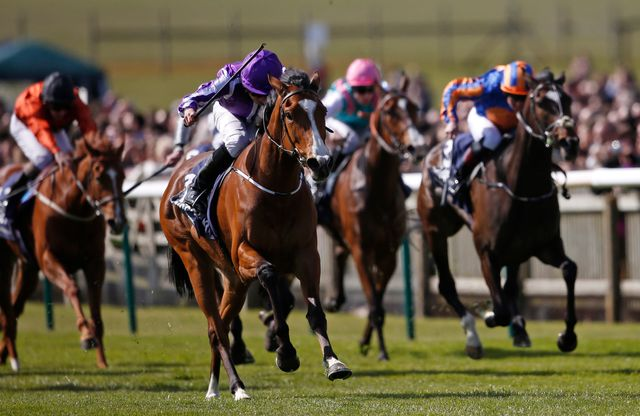 Ryan Moore and Minding come home clear of their rivals, headed by Ballydoyle (right).