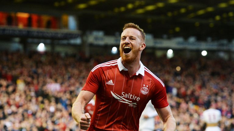 Adam Rooney scored a 90th minute winner to send Aberdeen through in the Betfred Cup