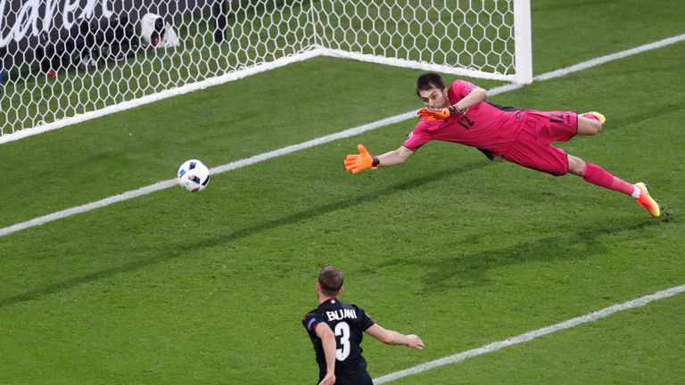 Albania's Ermir Lenjani somehow misses with the goal at his mercy