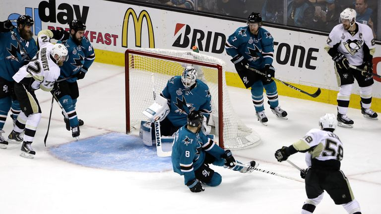Martin Jones #31 of the San Jose Sharks allows a goal to Kris Letang #58 of the Pittsburgh Penguins in the second period