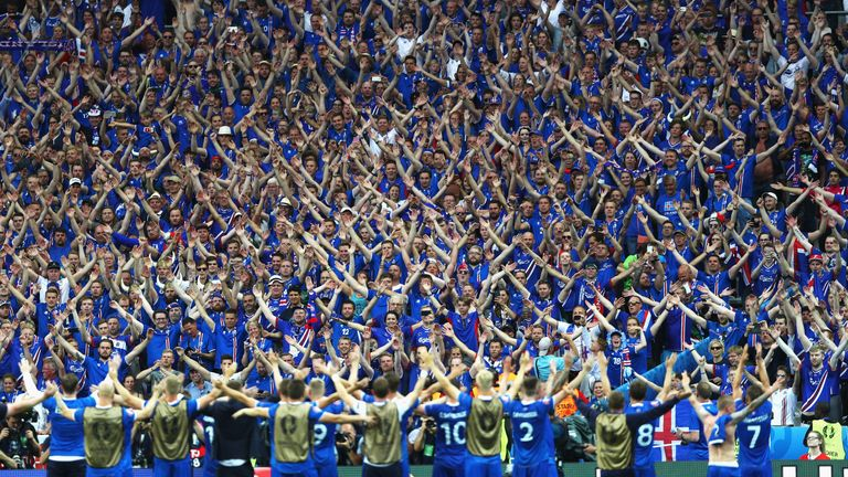 Iceland players and fans celebrate at the Stade de France