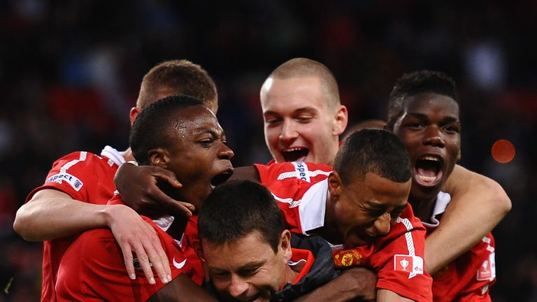 Paul McGuinness is mobbed by the likes of Lingard and Paul Pogba following United's FA Youth Cup Final win in 2011