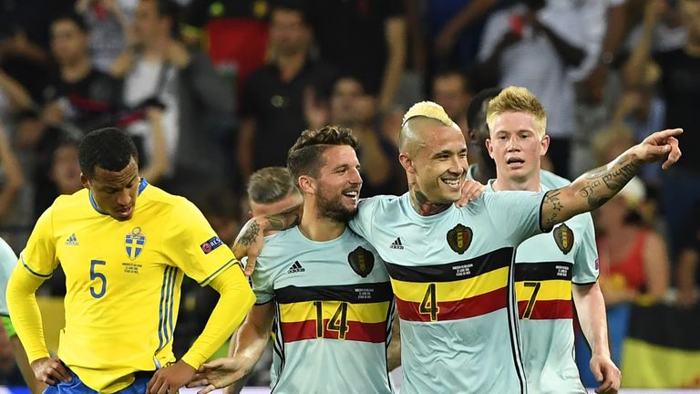 Nainggolan celebrates scoring against Sweden with Dries Mertens and Kevin De Bruyne