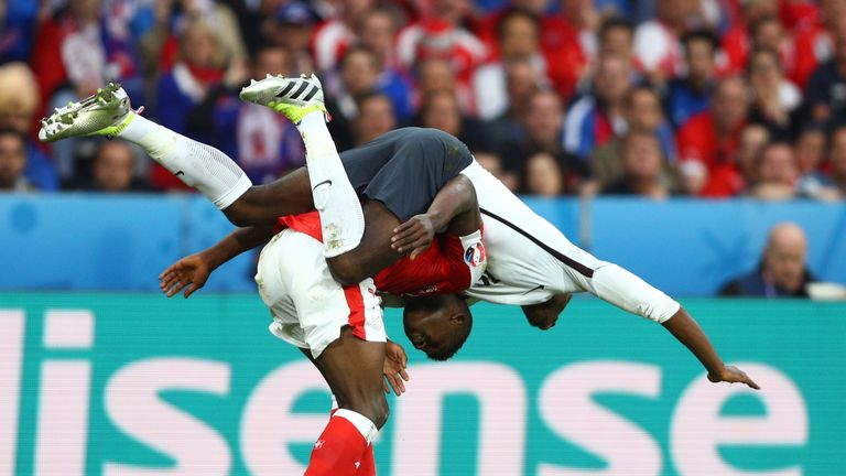 Paul Pogba goes over Breel Embolo in the first half in Lille
