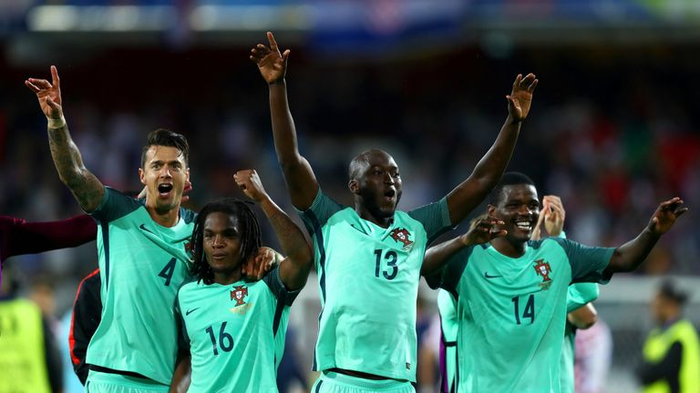 Portugal players celebrate at the end of extra-time against Croatia