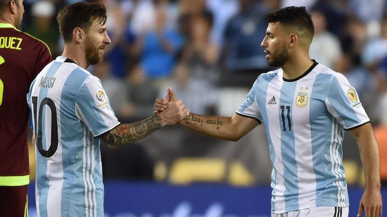 Messi (left) greets Aguero while on international duty for Argentina