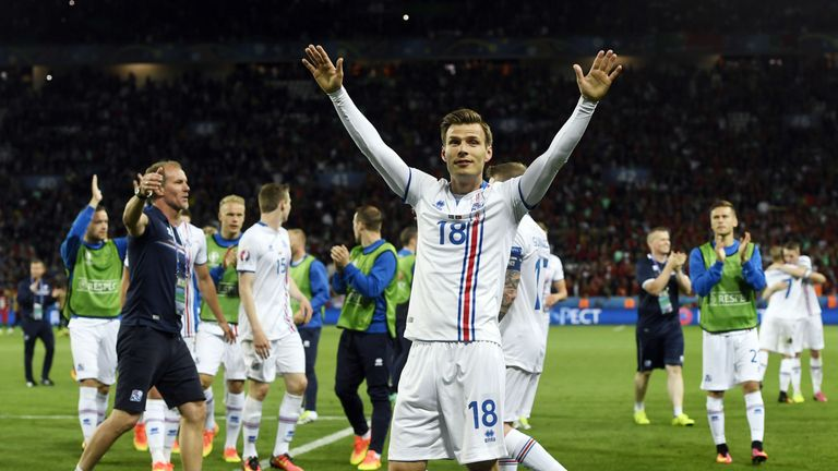 Iceland's Theodor Bjarnason (C) and his team-mates celebrate after the 1-1 draw