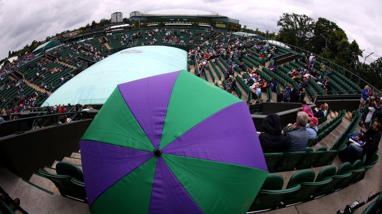 Umbrellas have been essential for spectators