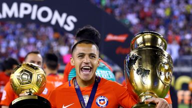 Alexis Sanchez celebrates with the Copa America trophy (right) and the Player of the Tournament award