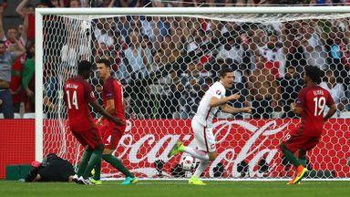 Robert Lewandowski opens the scoring for Poland