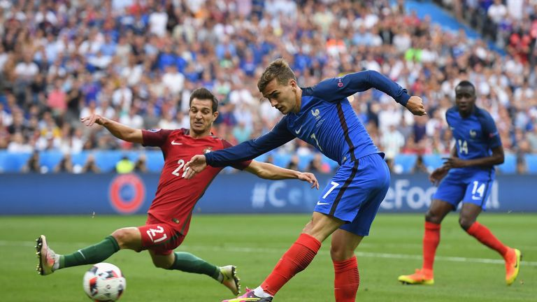 Antoine Griezmann shoots in the first half at the Stade de France