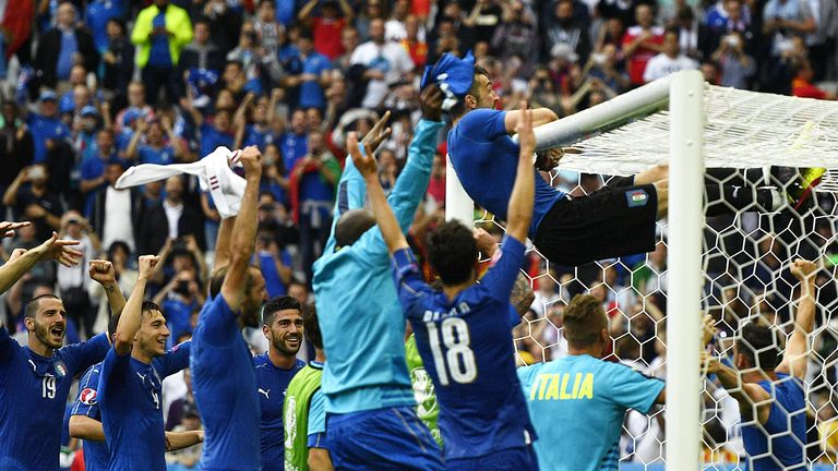Italy players celebrate their 2-0 win over Spain