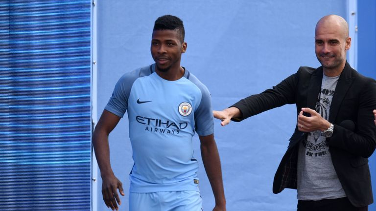 Kelechi Iheanacho is joined by new manager Pepe Guardiola as he models the new Manchester City home kit