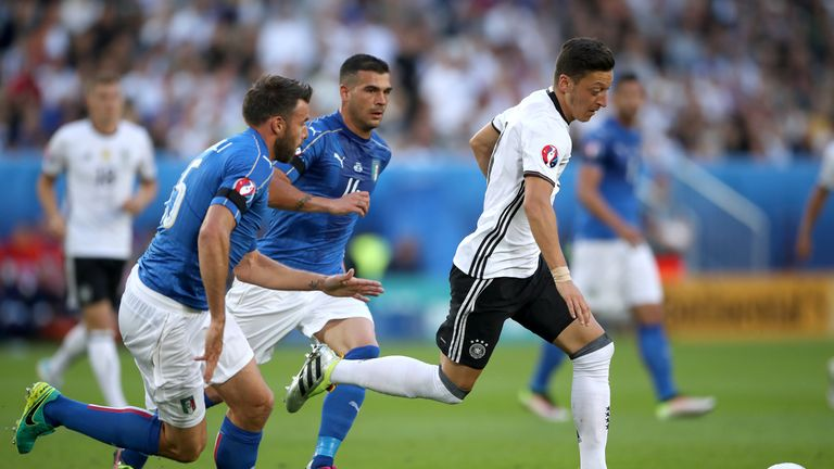 Mesut Ozil in action for Germany against Italy