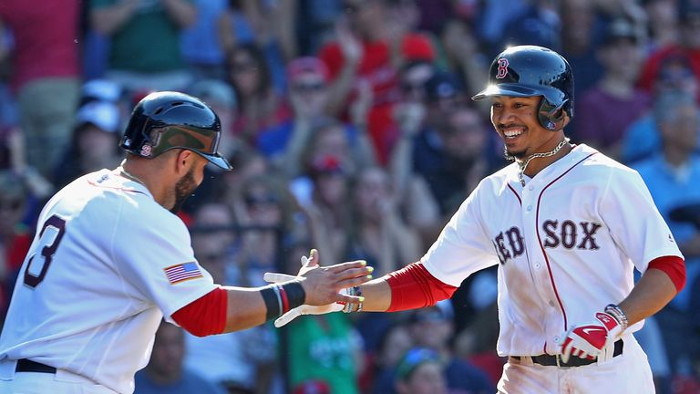 Mookie Betts (right) is having a great season for the Boston Red Sox