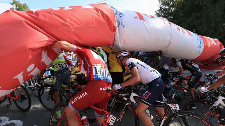 Cummings breaks free from peloton to win stage seven