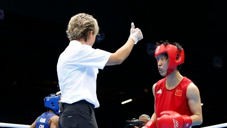 Nicola Adams beats Ren Cancan to reach final and defend her crown