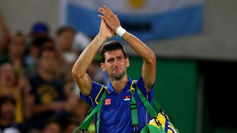 Djokovic struggles to hold back the tears following his first round loss to Argentina's Juan Martin Del Potro in the Rio Olympics