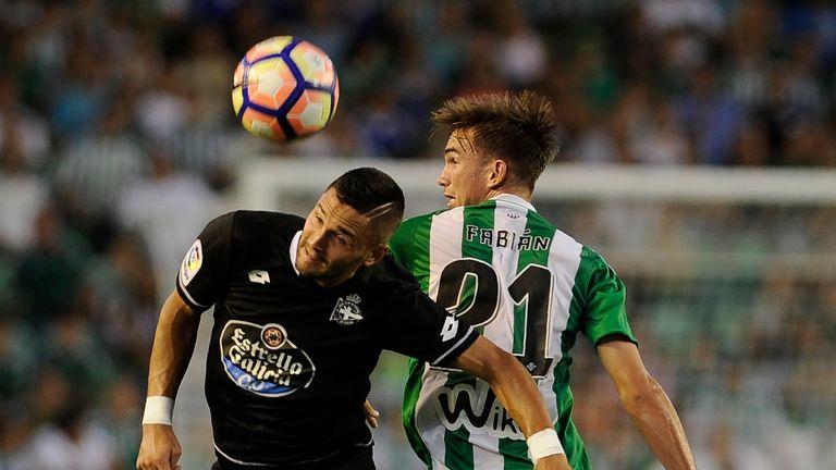 Deportivo La Coruna's midfielder Florin Andone (l) vies with Betis' midfielder Fabian
