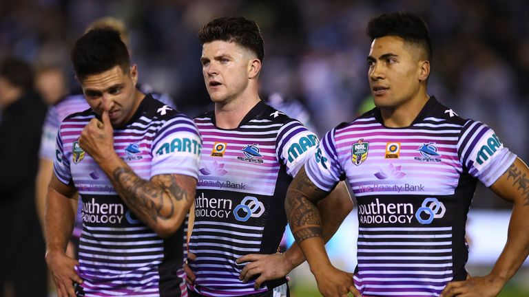 Gerard Beale, Chad Townsend and Sosaia Feki of the Sharks show their dejection after losing