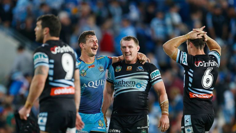 Greg Bird of the Titans and  Paul Gallen of the Sharks embrace after the 18-all draw