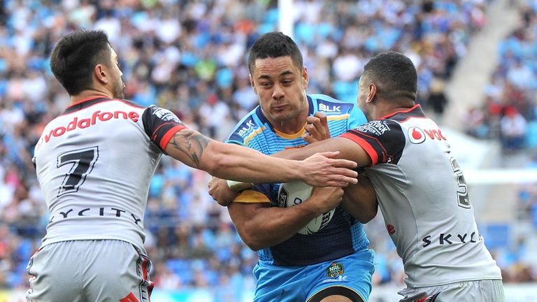 Jarryd Hayne takes on the defence in his first run for the Titans