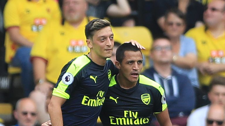 Arsenal's Alexis Sanchez (right) celebrates with team-mate Mesut Ozil