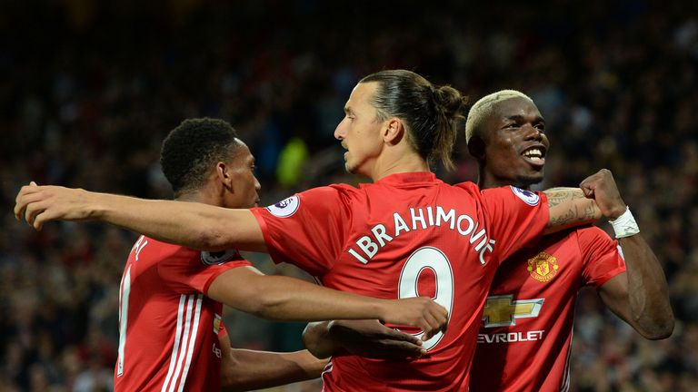 Zlatan Ibrahimovic (middle) celebrates with team-mates Paul Pogba (right) and Anthony Martial