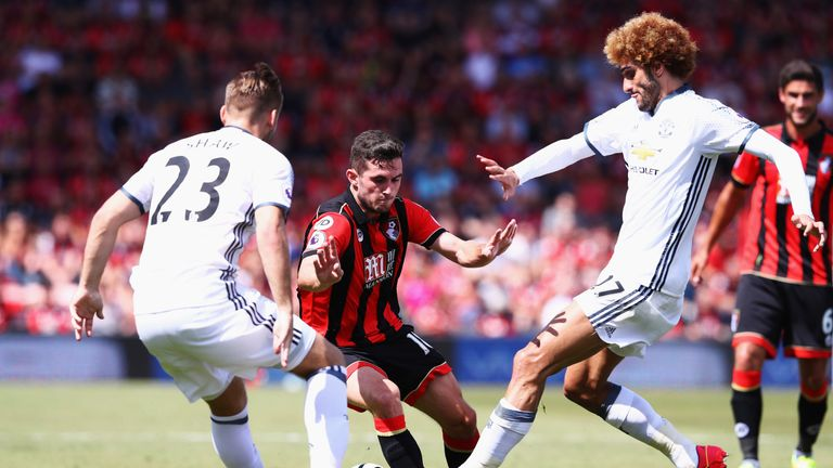 Lewis Cook takes on Luke Shaw (left) and Marouane Fellaini
