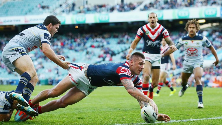Shaun Kenny-Dowall scores a try against the Cowboys