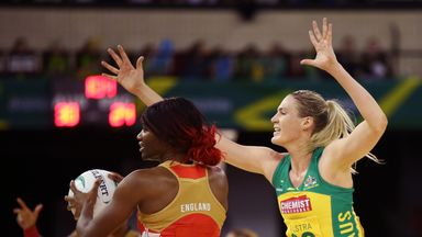 Caitlin Bassett of the Diamonds tries to block a pass by Ama Agbeze of the Roses