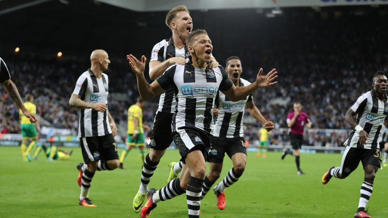 Gayle (centre) celebrates after scoring a late winner against Norwich as Newcastle win 4-3 at St James' Park