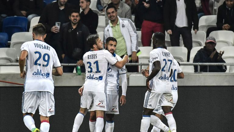 Nabil Fekir (C) celebrates with his team-mates after scoring in Lyon's 5-1 win at home to Montpellier