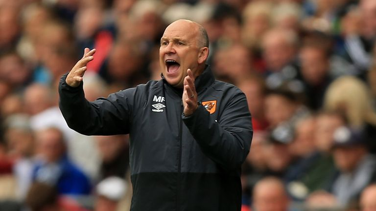 Mike Phelan is expecting a tough test at Anfield on Saturday