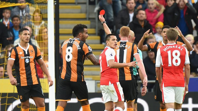 Jake Livermore (L) is shown the red card