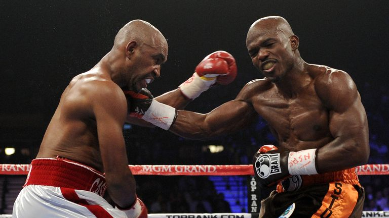 Timothy Bradley throws a right to the head of Joel Casamayor
