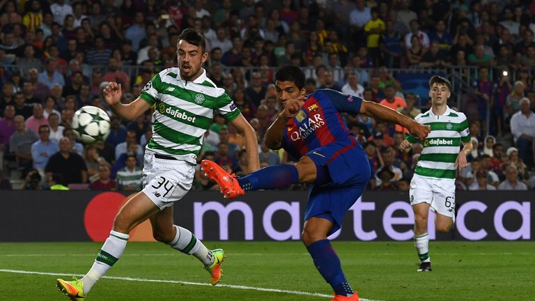 Luis Suarez volleys in his side's sixth against Celtic
