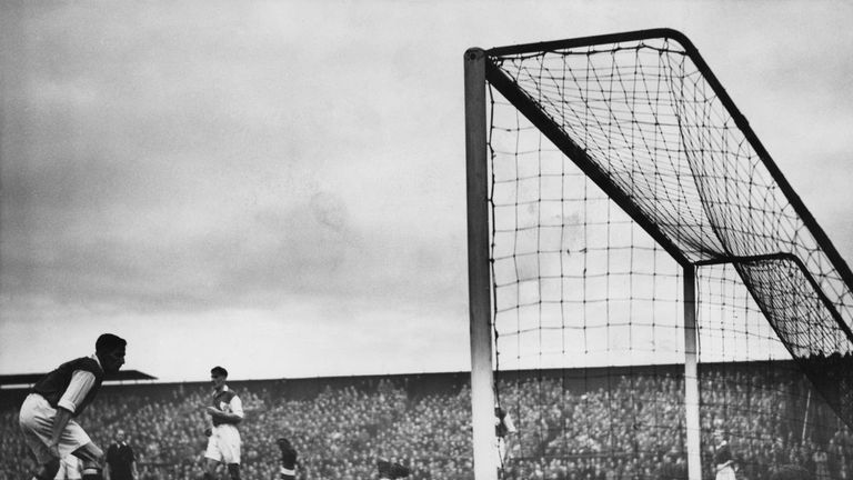 An action shot from Weymouth against Man Utd in the FA Cup third round in 1950, when Gibson was United chairman