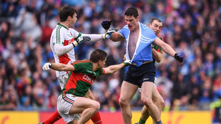 Diarmuid Connolly tussles with Mayo's David Clarke (left), Lee Keegan (second from left) and Keith Higgins