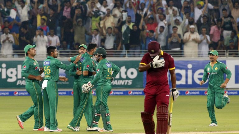 Pakistan's Imad Wasim (third left) picked up five wickets in Dubai
