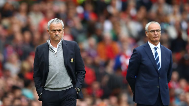 Jose Mourinho and Claudio Ranieri look on at Old Trafford
