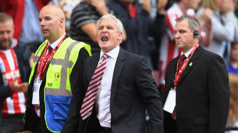 Mark Hughes reacts after being sent to the stands in Stoke's 4-0 loss to Tottenham
