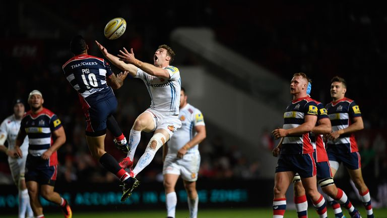Will Chudley contests a high ball with Tusi Pisi