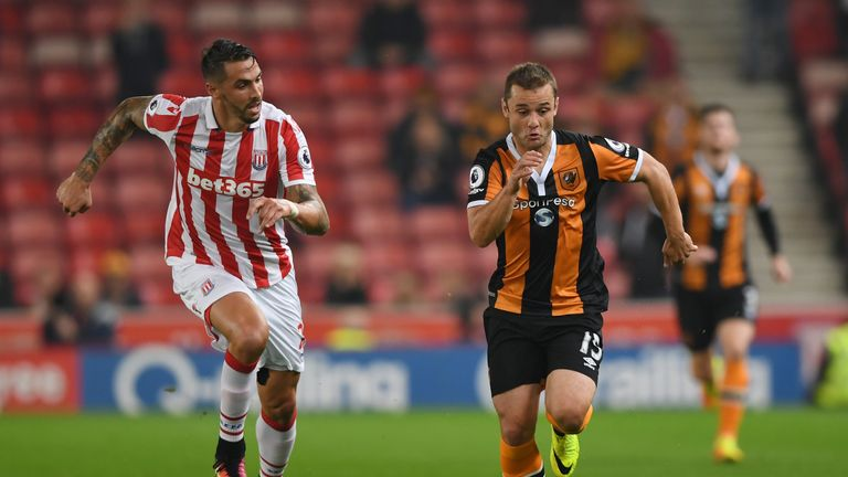 Shaun Maloney of Hull is tracked by Stoke's Geoff Cameron